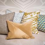 Cowhide Rug, Ivan Meade Signature Pillow in Miel, Textura in Miel, Vista Hermosa in Cenote, Grabado in Miel, Cubo in Miel/Cenote/Crema